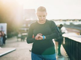 Female runner looking at her smart watch