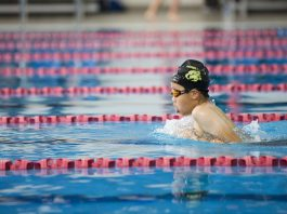 Young boy swimming in a race at AUT Millennium