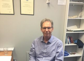 Dr Simon Mayhew in his clinic office